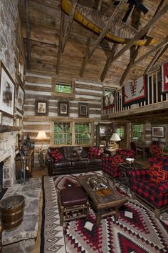 "Our finished log cabin living room at our ""Bath County Cabin"" in the mountains of Virginia - beautiful exposed beams, hardwood floors and a stone fireplace - your rustic retreat awaits. Work by: Country Mountain Homes www.countrymountainhomes.com"