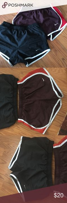 Two Pairs of Nike Shorts Gently worn. Size XS. One is a medium, but fits exactly the same as the XS. Nike Shorts