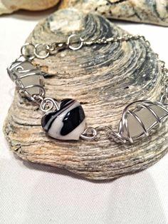 £7.99Unique sea glass and heart glass lampwork bead bracelet