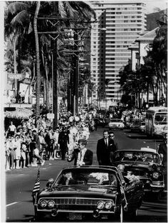 President John Kennedy came to Hawaii in June 1963 and was viewed by thousands in a well-attended motorcade. Here he's cruising along Kalakaua Ave. in Waikiki, with Hawaii Gov. John Burns seated in the back seat with him. Coincidentally, this is the same limousine in which the president was shot and killed in Dallas only 5 months later; it accompanied him in a separate plane on his travels.