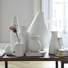 Pure White Ceramic Vases | west elm  these could be nice to mix in with colored bowls/vases. maybe put some stuff in these.