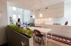 This kitchen has the minimalist lines I am thinking of for our kitchen.  Chelsey & Cainan's Fresh Start