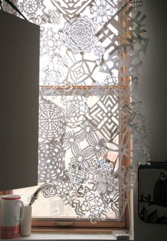 DIY Snowflake Curtains or hanging panels. I'd prob add a little sparkle here & there.