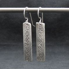 Sterling Silver Earrings The texture and patina that I have given these earrings creates depth with a blissful feeling that otherwise wouldn't be there. The Sterling Silver Ear Wires are hand-crafted…MoreMore  #SilverJewelry