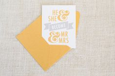Mr & Mrs wedding card by FMCstudio. Screen printed by hand in metallic gold and silver inks.