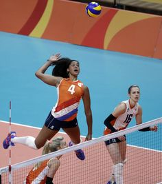 Netherlands' Celeste Plak (4) prepares to spike the ball along side teammate Debby Stam-Pilon (16) during a women's preliminary volleyball match against China at the 2016 Summer Olympics in Rio de Janeiro, Brazil, Saturday, Aug. 6, 2016. (AP Photo/Jeff Roberson)