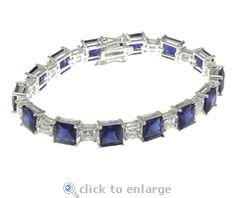 CZ Bracelet Princess Cut Square Sapphire Blue Cubic Zirconia 14K White Gold By Ziamond.  The Winston Inspired Princess Cube Bracelet features a 1.5 carat princess cut alternating with a .50 carat princess cut cubic zirconia.  $1795 #ziamond #cubiczirconia #cz #bracelet #princesscut #diamond #sapphire #jewelry