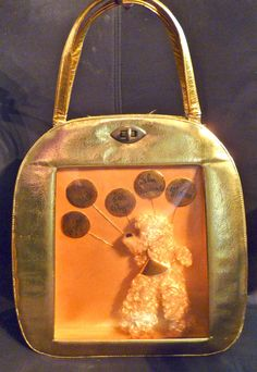 Fabulous '60s Pert Bag of California large gold purse with three-dimensional poodle behind a plastic windo.