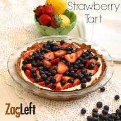 Strawberry Tart -a summertime treat filled with berries. Plenty of strawberries piled high on top of a creamy, heavenly filling and topped with a lovely strawberry glaze.