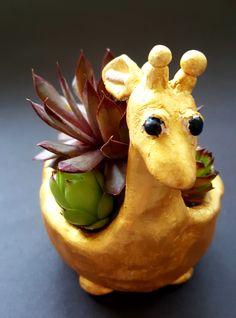 Pinch pot giraffe with hens 7th Art Ed Central