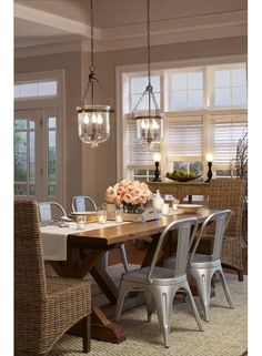 Farmhouse Dining Room with Unique Pendant Lights