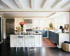 Love everything: color from rug, post+beam ceilings, color contrast in cabinets, light...