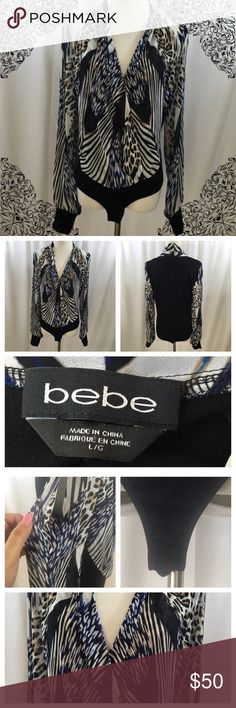 Bebe Long Sleeve Bodysuit Like new worn only once beautiful printed bodysuit featuring elegant georgette wrap front and sleeves with a fitted contrast jersey back. Sheer cutout sleeves. size L. Snap panty closure. 100% polyester bebe Tops Blouses