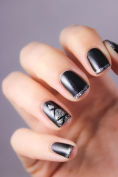 Matte black and Glittery silver nails with an abstract Christmas tree on the accent nail #festive #nailart...x