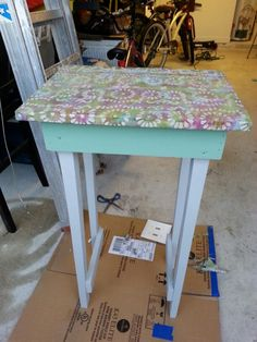 An old cast off table re painted and Mod Podge fabric top