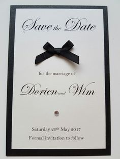 Classic save the date idea with a black bow and diamante detail