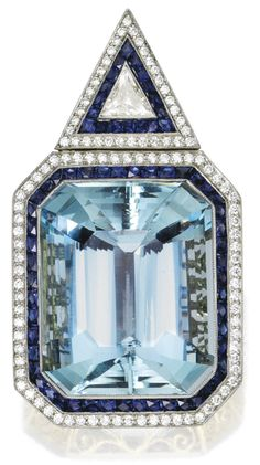 Contemporary aquamarine, sapphire, and diamond pendant.  It's centered by a huge emerald cut aquamarine (79 carats!) surrounded by calibré-cut sapphires and old European-cut diamonds. The pendant is topped by a triangular diamond and sapphire surmount. Total diamond weight, 2.05 carats. Total sapphire weight, 3.30 carats. Via Diamonds in the Library.