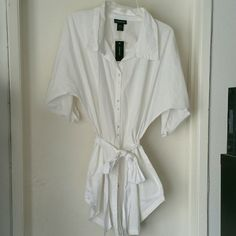 LOWEST MARKDOWN 💜NWT Lane Bryant Blouse/Waist tie New with tags! Paid $44.50. Beautiful Brand new w.tags Lane Bryant White blouse with waist tie. Flowy light material with quarter button up sleeves. Goes perfect with anything & even has little pouch with extra buttons.  Has just been sitting in my closet.  Perfect blouse for the summer! True to size 14/16 Lane Bryant Tops