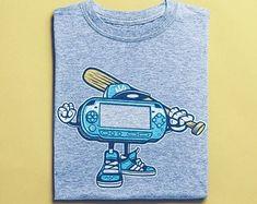 View Surf Shirts by BuyVintageShirts on Etsy Surf Shirt, T Shirt, Skater Shirts, African Safari, Vintage Shirts, Tshirts Online, Etsy Seller, Supreme T Shirt, Vintage T Shirts