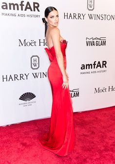 The pre-Fall '16 Marchesa scarlet gown Adriana Lima  attend the annual amfAR Gala in New York City might be the steamiest — but also most fun — look we've seen her sport on a red carpet yet.