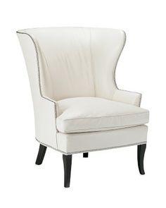 I love the Chelsea Wing Chair on Williams-Sonoma.com, in natural raffia. Love.