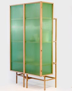 Dutch designer Dik Scheepers has created the Sine Cabinet, a cabinet made of oak, PVC, and brass