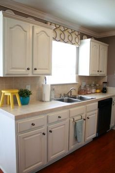 White painted cabinets with distressed finish (Danish oil used for distressing)