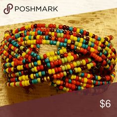 Seed bead Cuff Bracelet You are looking at a triple strand multi colored cuff bracelet, fits most wrists, match about anything in your wardrobe Jewelry Bracelets
