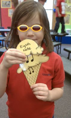 Students go on a scavenger hint around the music room looking for 2 scoops of ice cream to go with their musical symbol.