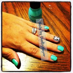 Sea Green with a black and white tribal accent nail. Love this one.