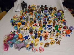 Omg! Ponies, Nemo, Dalmatians, Dumbo, Pete's Dragon, Georgette, Cha-Cha, TaleSpin, Lion King, the Mccy-D's food toys, etc...some that I have (such as Georgie! <3) and a lot similar to ones I have/had...awesome set