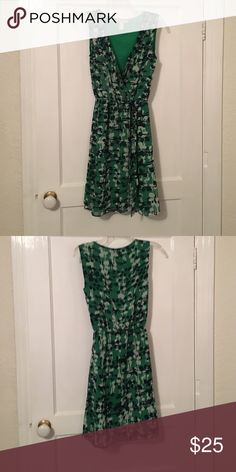 Sleeveless dress! Green with navy & cream designs! Great condition. Missing the belt. Banana Republic Dresses Asymmetrical