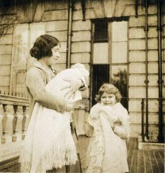 a rare photo of Queen Elizabeth the Queen Mother with Princess Elizabeth of York and the infant Princess Margaret Rose