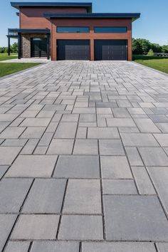 This driveway landscaping design was inspired by our Blu Collection! Smooth and sleek, Blu 80 mm Smooth is the perfect driveway paver to fit any modern home's exterior. Pave luxurious walkways, driveways and more with this paver! Modern Driveway, Driveway Design, Driveway Landscaping, Modern Landscaping, Driveway Pavers, Landscaping Design, Outdoor Walkway, Front Walkway, Backyard Patio