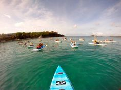take a pilates class on a paddle board