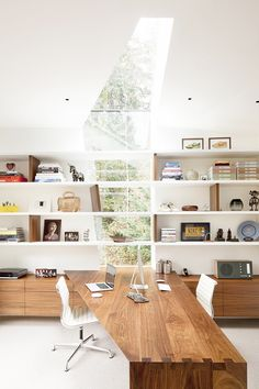 Clear white beautiful interior with wooden desk en big window