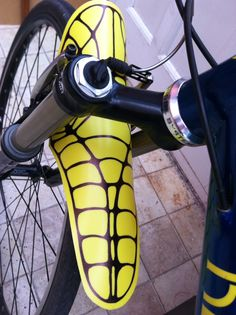 Yellow skeleton mudguard attached to MTB.