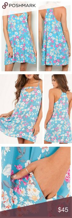 Aqua blue floral keyhole dress New aqua blue floral sleeveless dress with scoop neck. Keyhole neck design, pockets  100% polyester Made in USA  Tags: summer spring vacation resort wear mini flowers vacation Dresses Mini