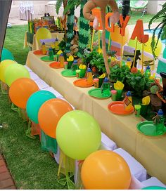 Jungle themed party. Good use of balloons!