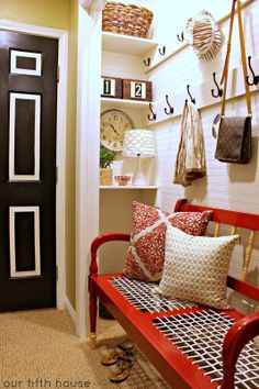 With the removal of closet doors, this tight hallway gains a mudroom that opens the space and greets entrants. | thisoldhouse.com