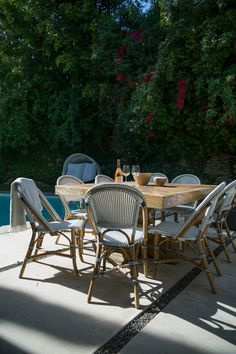 Louise Roe's backyard patio with Serena & Lily's Riviera Side Chairs