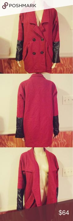 Wool Maroon Peacoat Lined Long Karmaloop Coat Red Wool peacoat by Cotton Candy from Karmaloop.  Burgundy in color.  Fully lined.  50% wool, 50% polyester, 100% polyester lining.  Collared with a long v-neck.  2 functional buttons on the front with a button across from eacb for a symmetrical look.  1 inside button to help keep the coat closed.  2 front pockets.  Each sleeve has long black pleather cuffs.  Pre-owned with some general fuzziness allover due to the wool content but overall great…