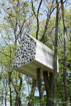 A tree house for 1 person and 78 birds. You climb in the other side and can view the birds through peep holes.