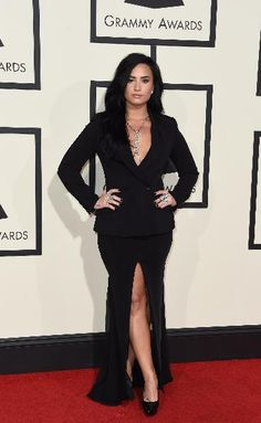 Demi Lovato arrives on the red carpet for the 58th Annual Grammy music Awards in Los Angeles February 15, 2016.