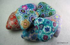 pile of polymer clay hearts by @carajane