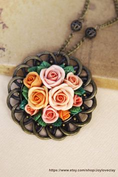 charm necklace, vintage pendant necklace ,handmade flowers necklace , jewelry , bronze, polymer clay flower, handmade jewelry, pendant. $30.00, via Etsy.