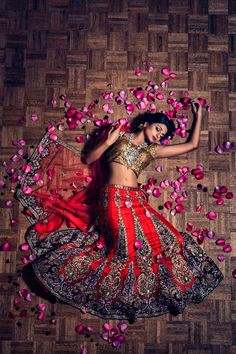 Photo by Studio Uma (www.studiouma.com) Stunning red and gold bridal lehenga. From Almas Tejani Desi Couture in Sugar Land, TX.