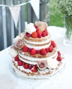 Topped with summer roses and thick strawberries, it doesn't get much sweeter than this naked cake from Top of the Hill Bakery in Ontario, Canada #InStyle