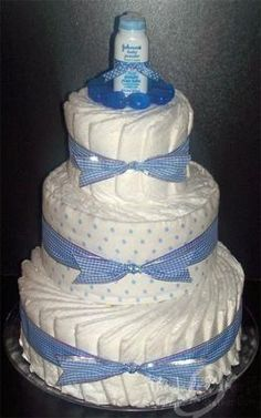diaper cakes for boys | Now enhance the diaper cake's first level with 7 more diapers to be ...