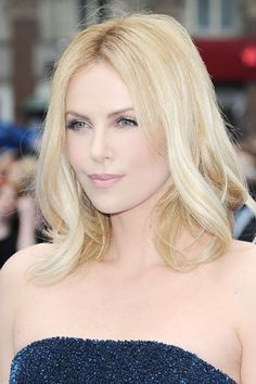 Photo by: Eamonn McCormack/WireImage  Charlize Theron's Shoulder Skimmer  The flippy layers draw attention to the face while the soft texture-best achieved on fine to medium hair-adds a feminine feel.